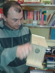 parent making bird box in class